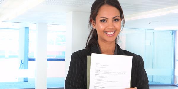 Person holding a CV